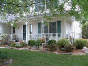 covered porch wrap around deck veranda classic white columns