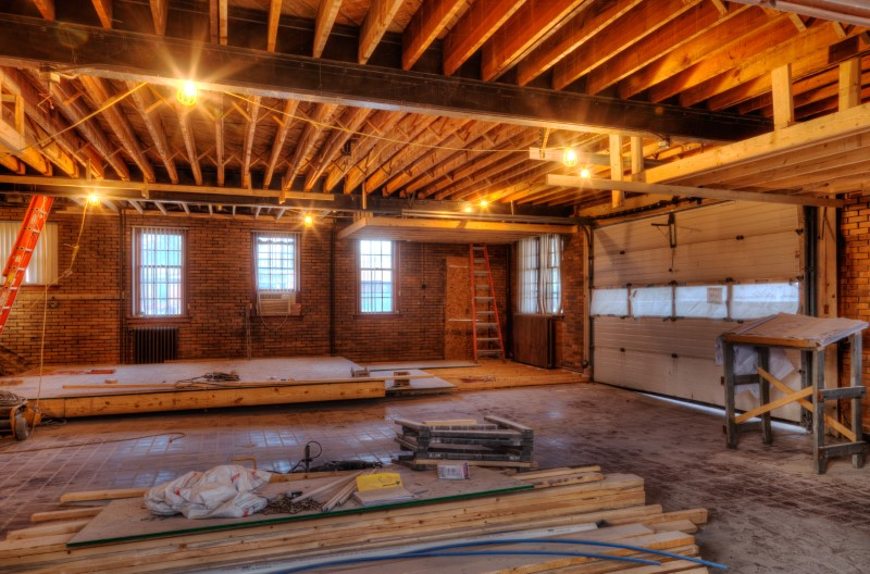 historic remodel in progress exposed beams re use old material