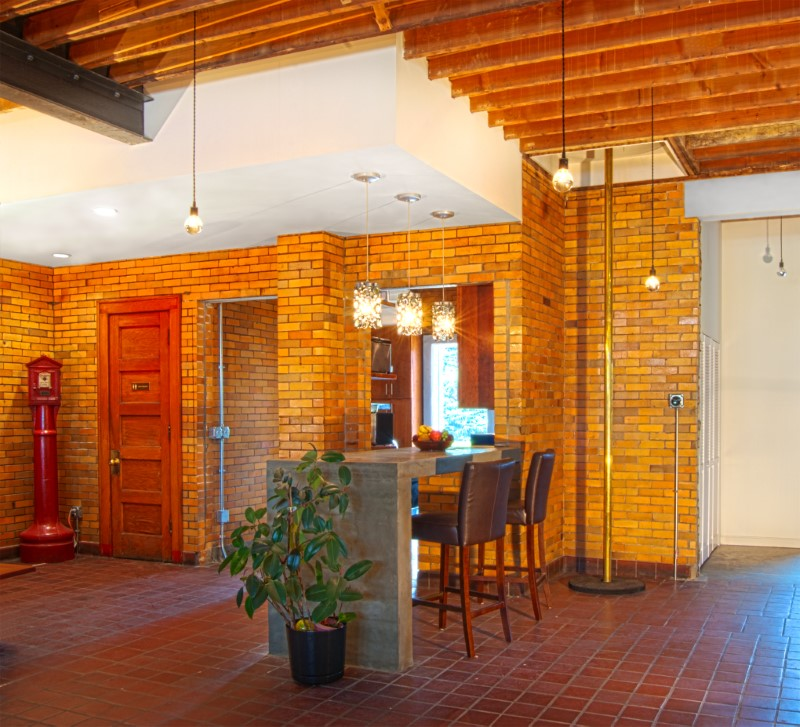 historic remodel re use material brick exposed beams