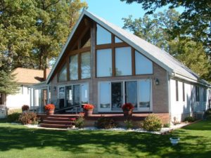 outdoor living lake house window wall masonry patio lattice