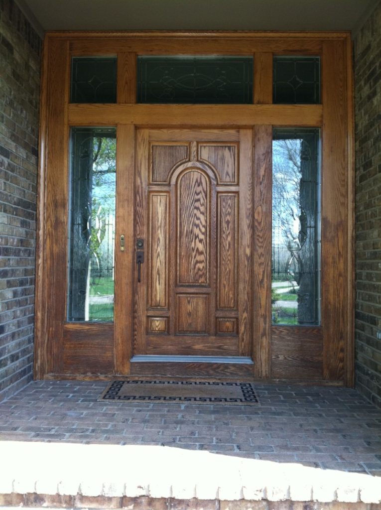 paneled front door stained glass side lites windows above